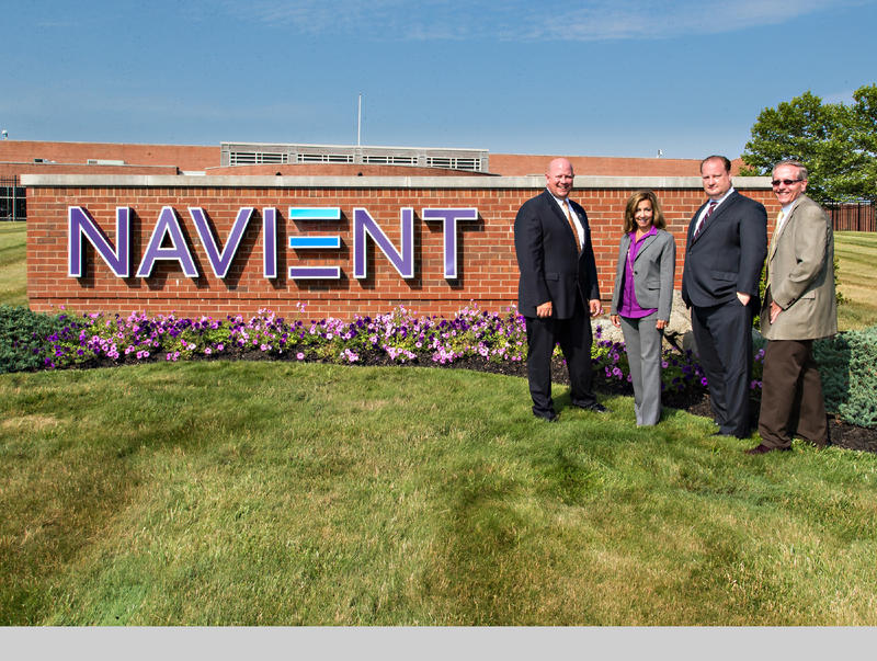 Local officials pose for the unveiling of Navient's new sign outside of the company's offices in Wilkes-Barre, Pa., on July 2, 2014.