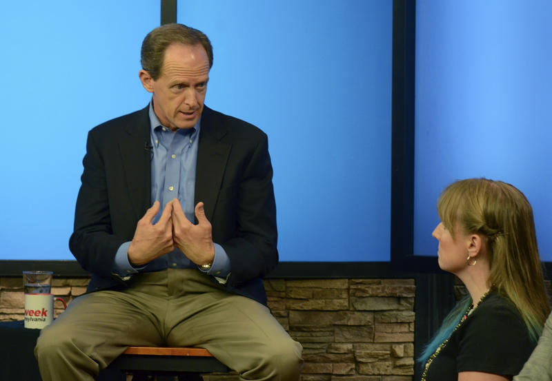 Pennsylvania U.S. Sen. Pat Toomey answers a question from Nancy Rohrbaugh, of Dillsburg, Pa., right, during an hour-long question-and-answer session in the studios of WHTM-TV, Wednesday, July 5, 2017.