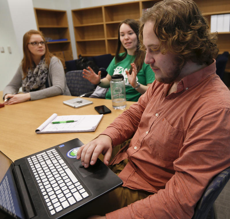In this Tuesday, Feb. 7, 2017 photo, Penn State student Jesse Weber, right, looks over his laptop at fellow students as they exchange ideas for a Stand for State team meeting.