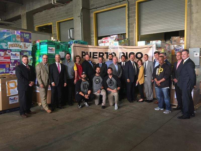 Pirates players, coaches, staff and sponsors pose for a photo in front of supplies gathered for Puerto Rico relief efforts on Wednesday, Oct. 4, 2017.