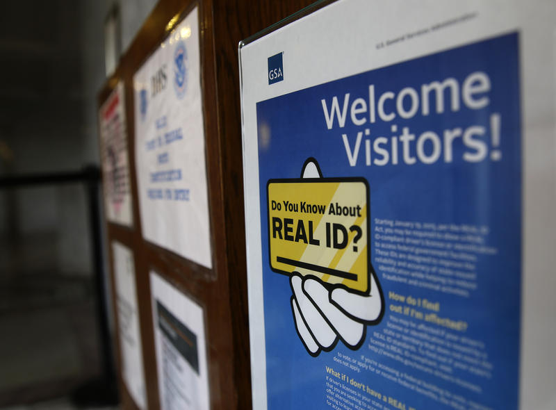 In this photo taken April 6, 2016, a sign at the federal courthouse in Tacoma, Wash., is shown to inform visitors of the federal government's Real ID act, which requires state driver's licenses and ID cards to have security enhancements.