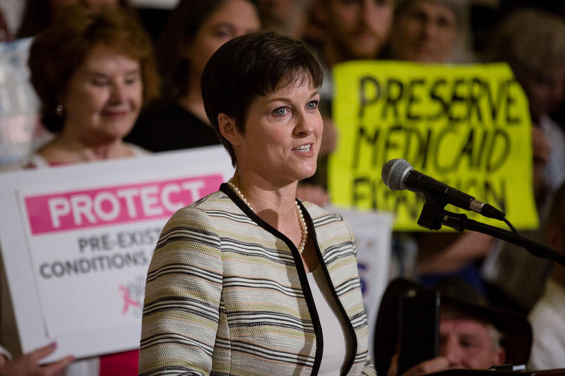 Then-insurance commissioner Teresa Miller speaks at a health care rally at the state Capitol in Harrisburg on June 23, 2017.