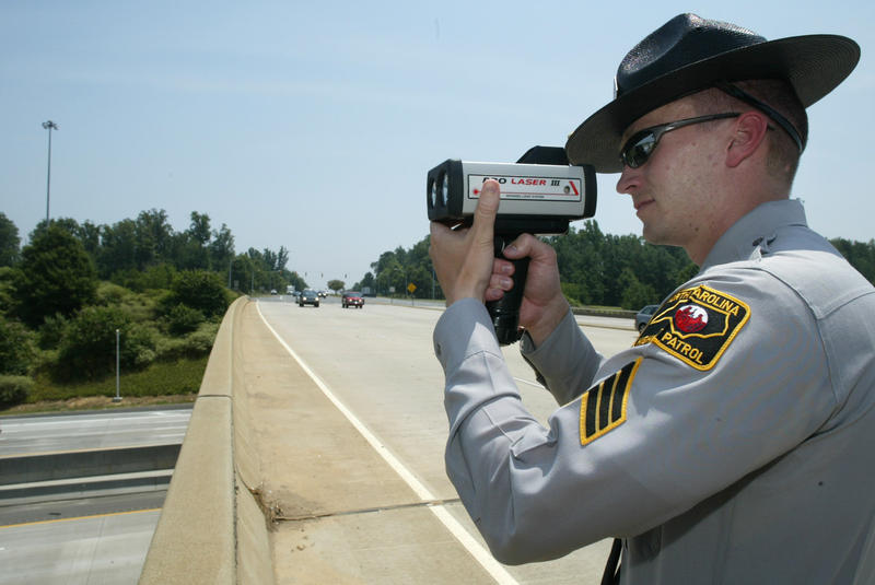 North Carolina Highway Patrol Sgt. Stuart Mitchel uses a radar gun to track the speed of cars on Interstate 85 in Charlotte, N.C., Monday, July 25, 2005. Police in Pennsylvania municipalities can now use the radar guns to monitor traffic.