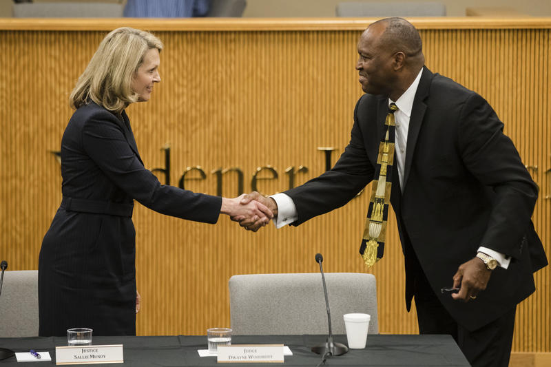Pennsylvania Supreme Court candidates Republican Sallie Mundy, a justice on the state Supreme Court, left, and Democratic candidate Dwayne Woodruff, a common pleas court judge in Allegheny County shake hands at the end of a debate at Widener University.