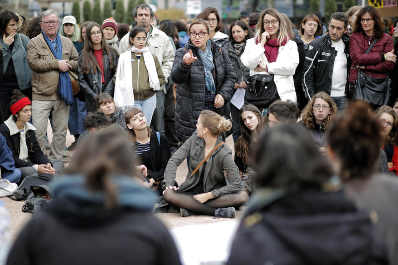 Women talk during a debate as part of a demonstration to support waves of testimonies denouncing cases of sexual harsassment on Sunday, Oct. 29, 2017. Women are protesting under the #metoo banner in the wake of mounting allegations against powerful men.