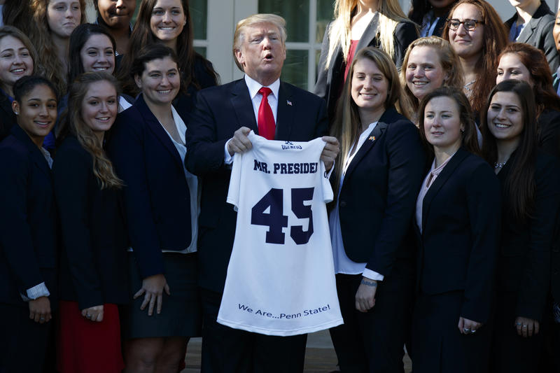President Donald Trump poses for photographs with the Penn State women's rugby team during an event with NCAA championship teams at the White House, Friday, Nov. 17, 2017.