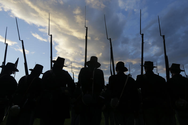 Re-enactors portray Union soldiers on the 150th anniversary of the Battle of Gettysburg.