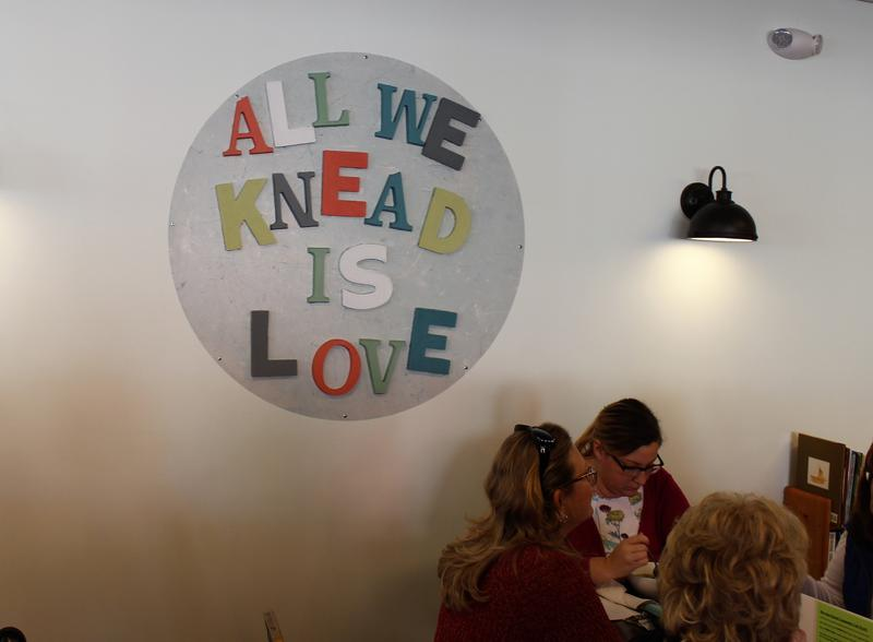A sign on the wall of Knead Community Cafe in New Kensington, Pa. reflects the restaurant's mission to serve healthy meals to people struggling socioeconomically.