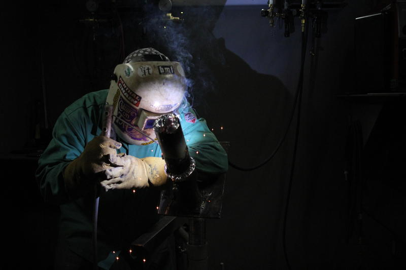 A student training at the Steamfitters Technology Center In Harmony practices welding technique.