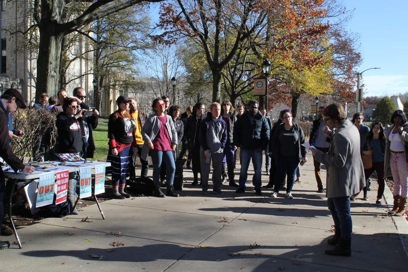 Students and faculty listen to speakers Wednesday at a protest of a federal bill's impact on higher education.