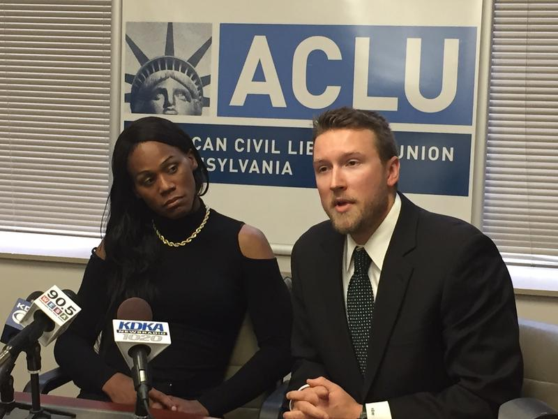 Plaintiff Jules Williams and civil rights attorney Alec Wright speak at a press conference Monday.