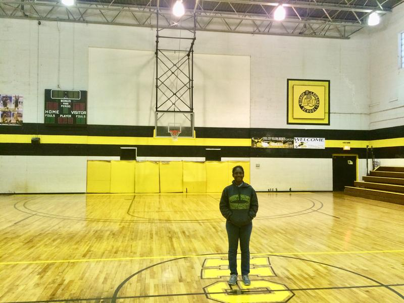 Kristee Cammack, founder of the Allentown nonprofit A Giving Heart, stands in the refurbished basketball court in her organization's building.