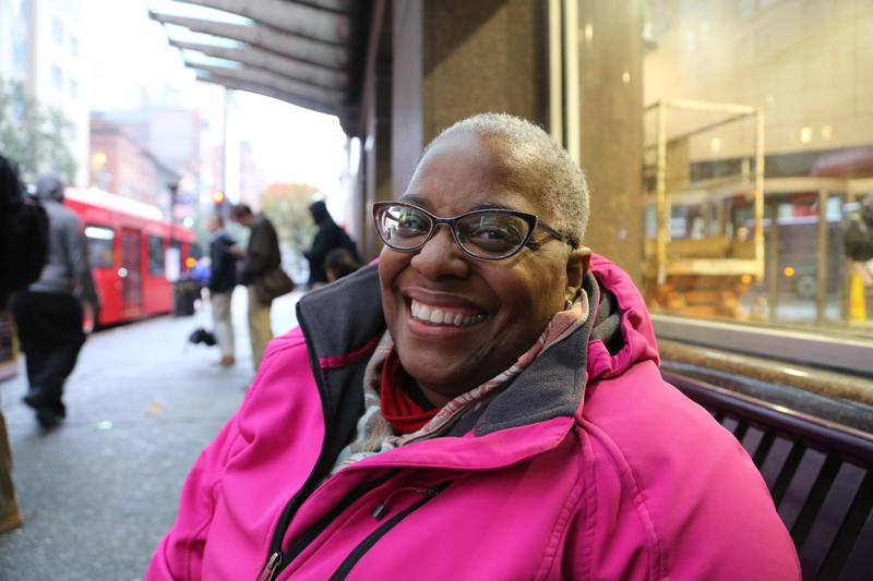 Pamela Edwards waits for the first bus of her trip home at Wood Street station in downtown Pittsburgh.