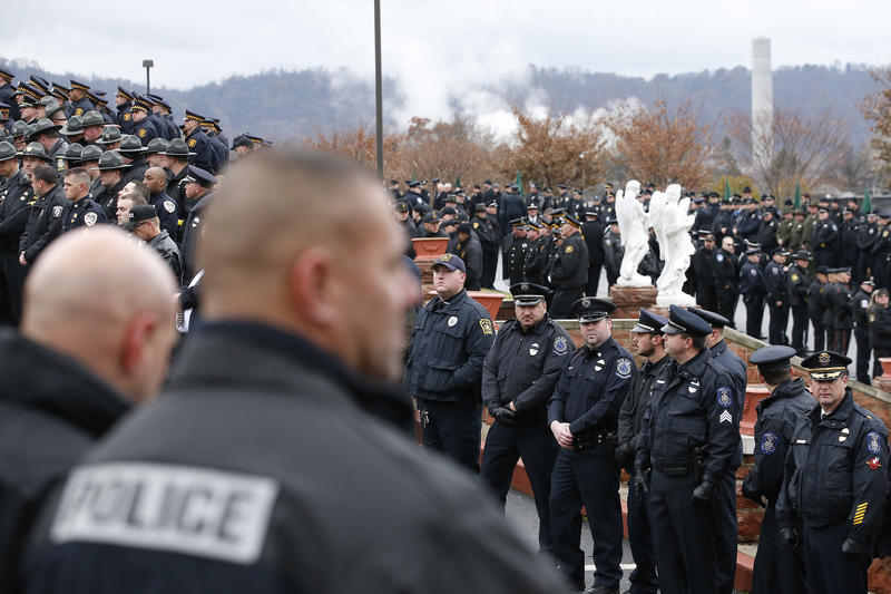 Thousands of police officers attend the funeral for slain New Kensington Police Officer Brian Shaw at Mount St. Peter Church in New Kensington, Pa., Wednesday, Nov. 22, 2017.