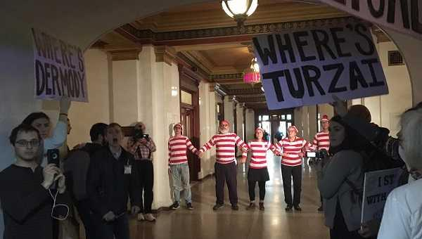 "Activists, some dressed like the character from the ""Where's Waldo"" books, walked three days to the Capitol building in Harrisburg, where they were eventually arrested for blocking a hallway."
