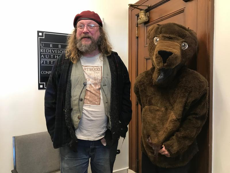 Matt Peters of Heartwood accompanying Baby Bear to the URA meeting on Thursday, Nov. 9, 2017.