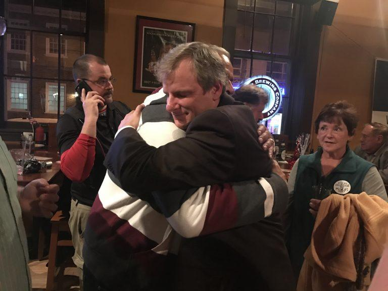 York City Council President Mike Helfrich embraces a supporter after winning the mayoral race.