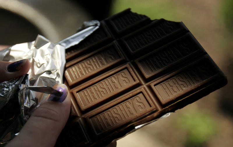 A Hershey chocolate bar is held on Thursday, July 21, 2005. The company debuted its new candy bar for the first time in 30 years Thursday, featuring peanuts and pretzels.