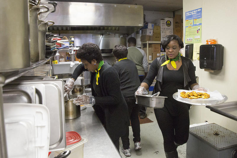 "Employees prepare food at the Parkway Caribbean Restaurant in Allentown, Pa. Gov. Tom Wolf visited the restaurant in March 2016 as part of his ""Jobs that Pay"" tour."