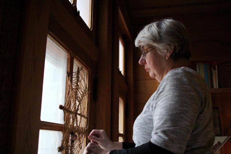 Marika Zaliszczuk adorns the Ukranian room with a traditional spider web wreath.