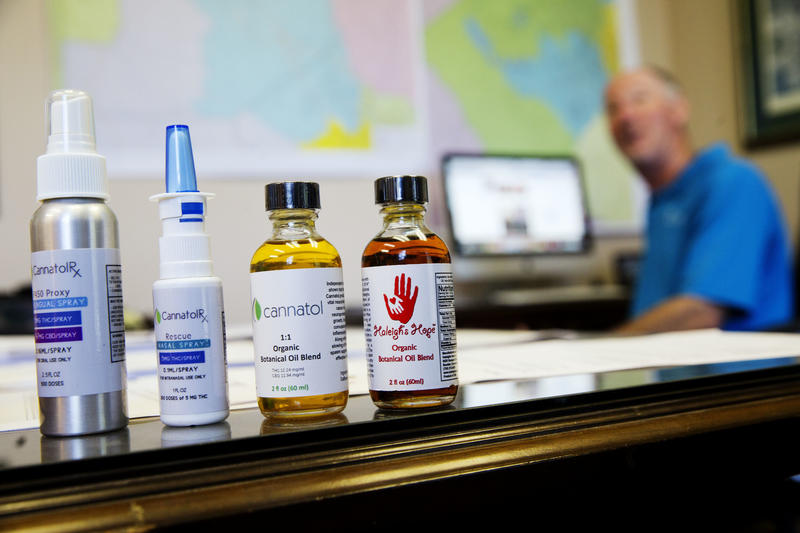 In this Monday, April 17, 2017 photo, various cannabis oil products are displayed for a photo in the office of Georgia State Rep. Allen Peake.