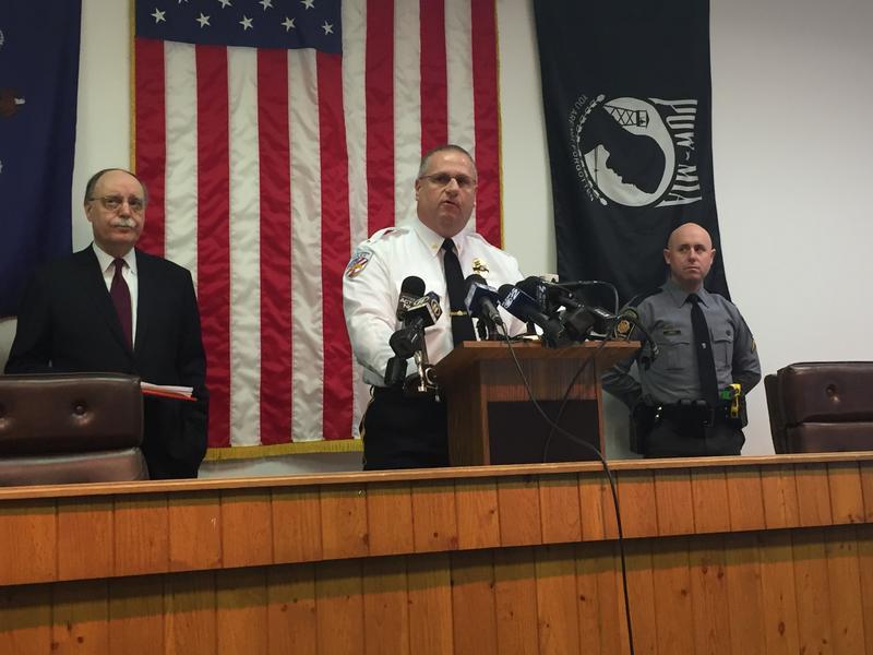 Westmoreland County DA John Peck (left), New Kensington Police Chief Jim Klein (center), and State Police Press Officer Steve Limani (reader).