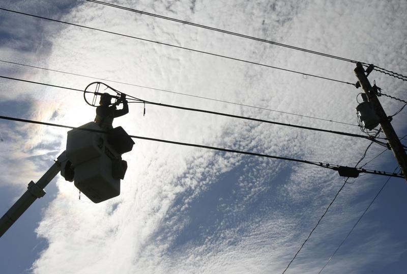 A worker installs fiber-optics in rural Vermont.