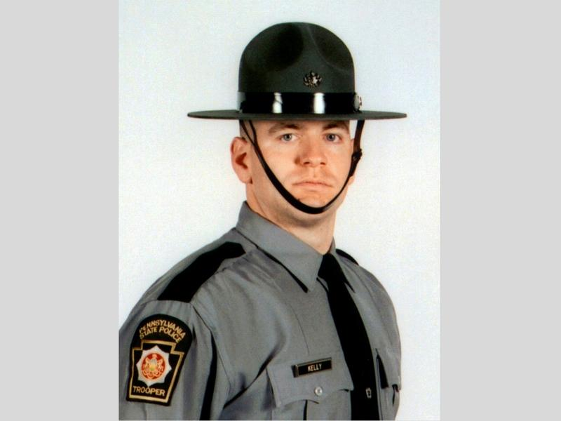 In this undated photo released by the Pennsylvania State Police, Cpl. Seth J. Kelly is shown.