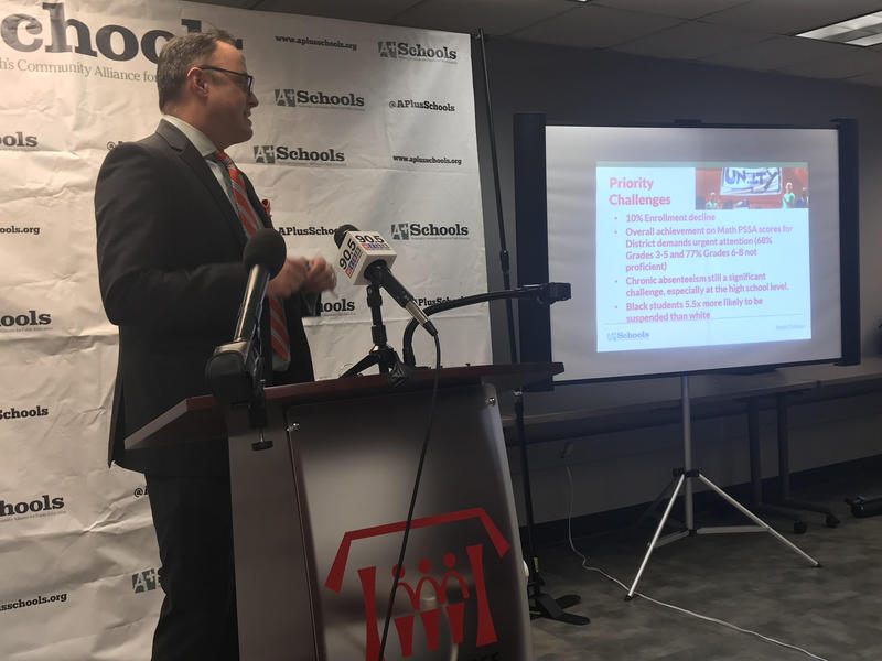 A Plus Schools Executive Director James Fogarty points to a slide showing his nonprofit's priorities for the Pittsburgh Public School District at a press conference Monday.