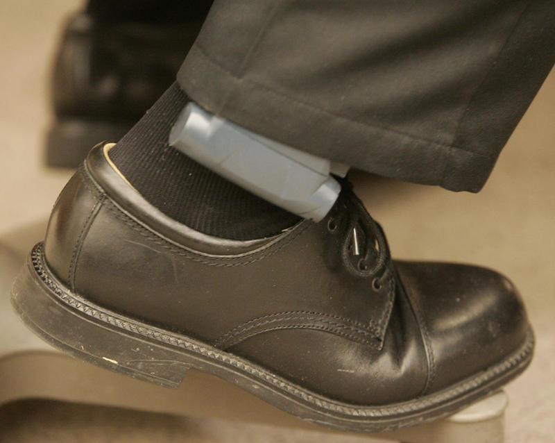 A man wears an electronic monitoring device on Friday, Dec. 21, 2007 in the Second District Court in Farmington, Utah.