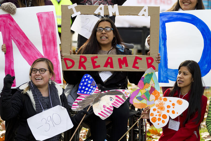 Demonstrators chant slogans during an immigration rally in support of the Deferred Action for Childhood Arrivals (DACA), and Temporary Protected Status (TPS) programs, on Capitol Hill in Washington, Wednesday, Dec. 6, 2017.