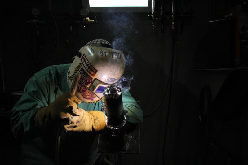 An apprentice with the Steamfitters Local 449 practices welding at the union's Harmony technology center. The state created a new program this week to expand apprenticeship programs.