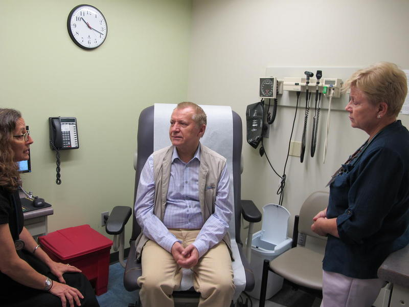 At the Squirrel Hill Health Center, an FQHC, Medical Director Andrea Fox treats patient Vladzimir Shein while Medical Office Assistant Rita Bidrat translates from Russian to English.