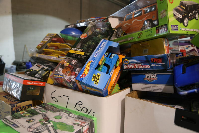 Volunteers sort donated toys by both age and gender for the U.S. Marines' Toys for Tots collection.