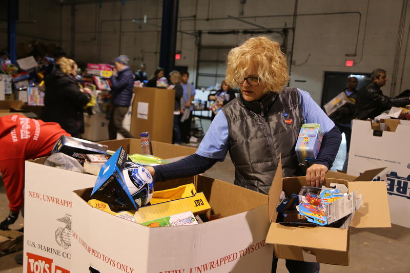 Leigh Ann Libert sorts toys during her first Toys for Tots warehouse sorting and packaging event.
