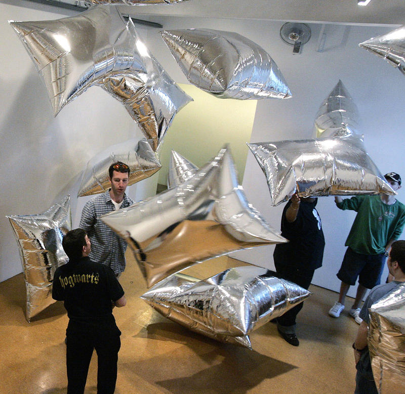 Students play with mylar balloons at an exhibit at the Andy Warhol Museum on the North Side.
