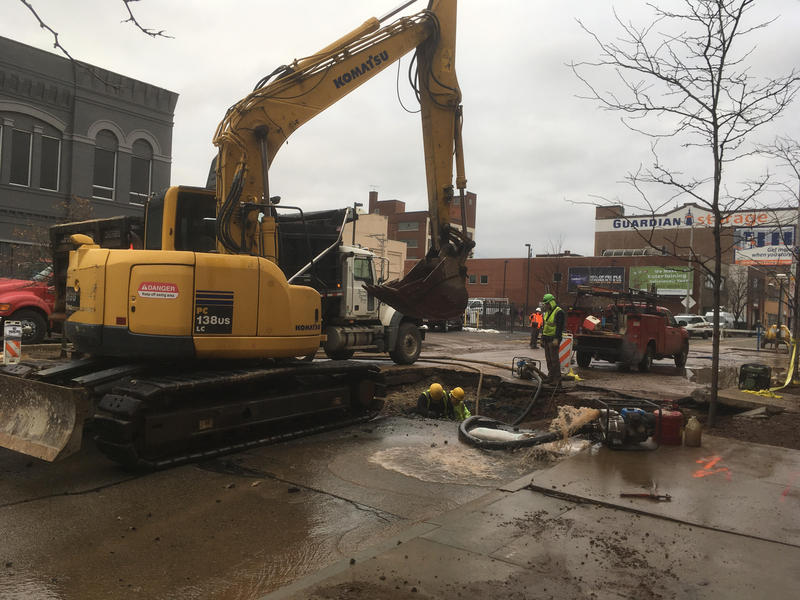 A crew works to repair a 20-inch water main break on Centre Avenue on Monday, Dec. 18.
