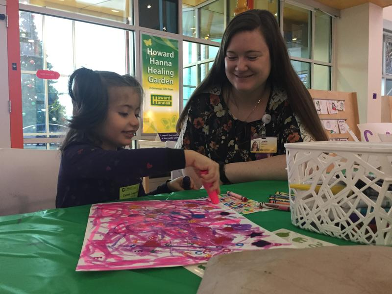 Carmen Ortega-Cavara, 4, colors with Lakin Weaklan, an art therapy extern at Pittsburgh's Children's Hospital. Ortega-Cavara is one of the 180,000 Pennsylvania kids covered by CHIP.