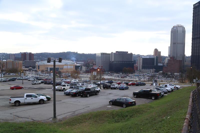 Under new development terms for a 28-acre site in the Lower Hill District, the Pittsburgh Penguins would forfeit 40 percent of parking revenues if they don't meet a 2023 deadline. Parking lots cover much of the parcel, pictured here.