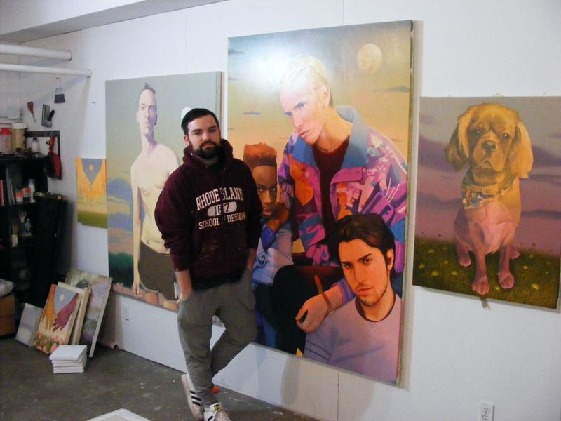 Painter Danny Ferrell in front of some of his work. Ferrell, originally from Altoona, Pa., says he finds that artists can make a living in Pittsburgh, partially due to the number of grants awarded by nonprofit organizations.