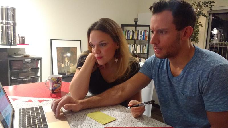 Ali Shaprio and her husband Carlos Queirós look over their health insurance options on the ACA exchange.