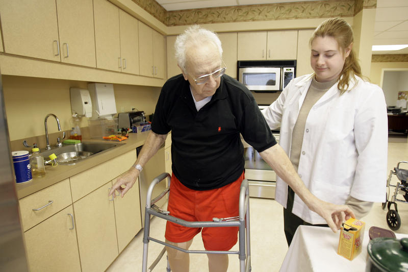 William Sayres, left, works with an occupational therapist at a nursing home in Hatboro, Pa.