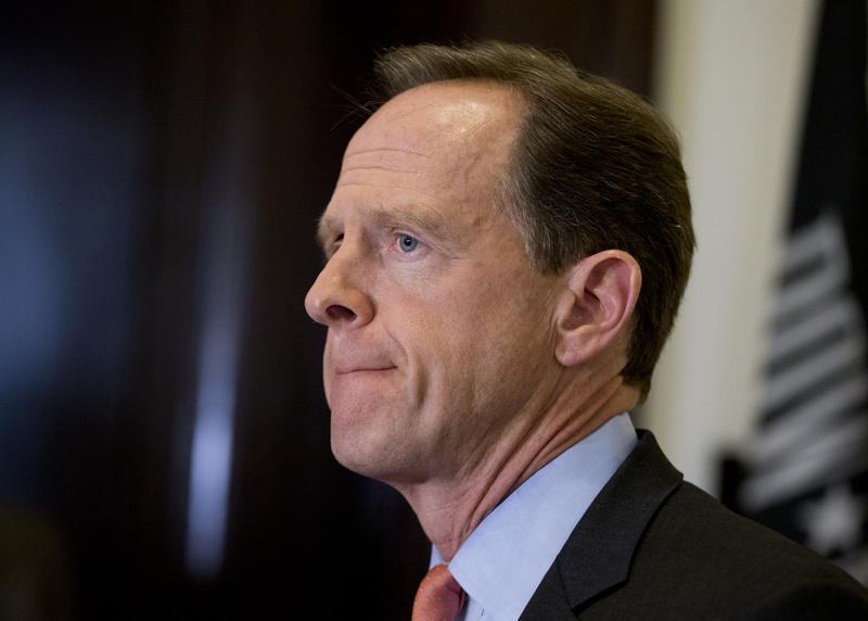 Sen. Pat Toomey speaks to reporters outside of his office in Capitol Hill on Tuesday, April 12, 2016.