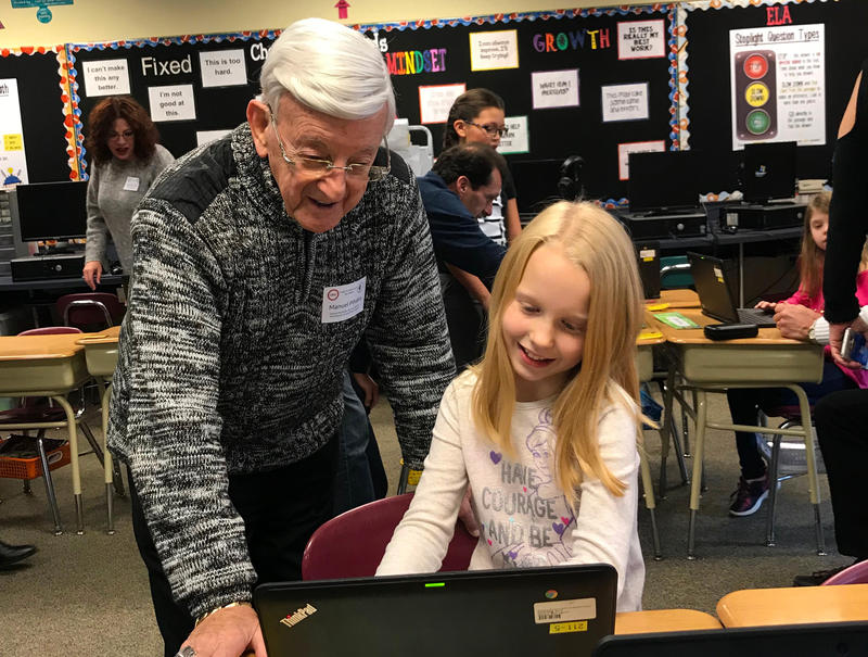 At South Central Elementary School in the Canon-McMillan District, third-grader Faith Davis shows school board member Manuel Pihakis a project she's been working on as part of the school's programming curriculum.
