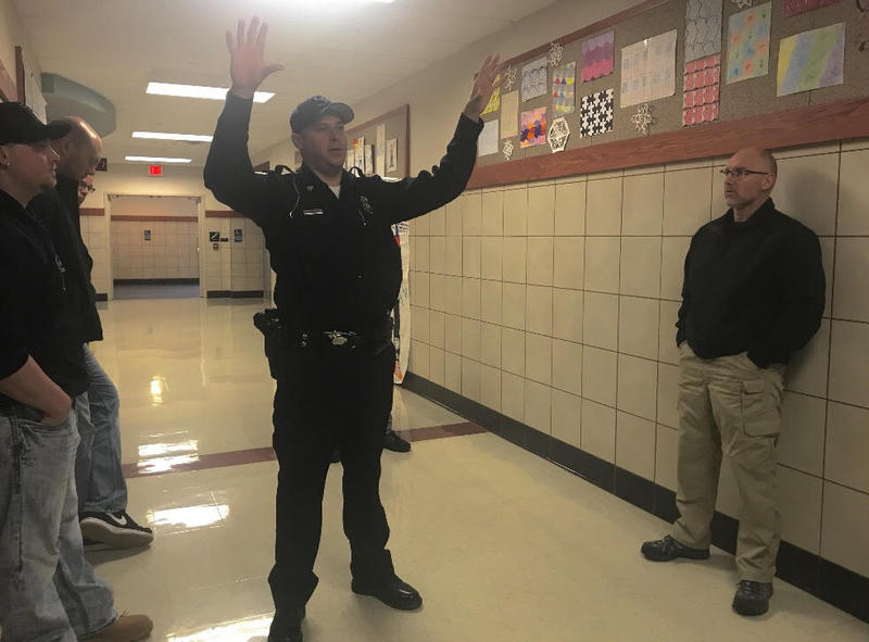 Quaker Valley School Police Officer Aaron Vanatta leads a training group through the middle school explaining ways he has secured the building.