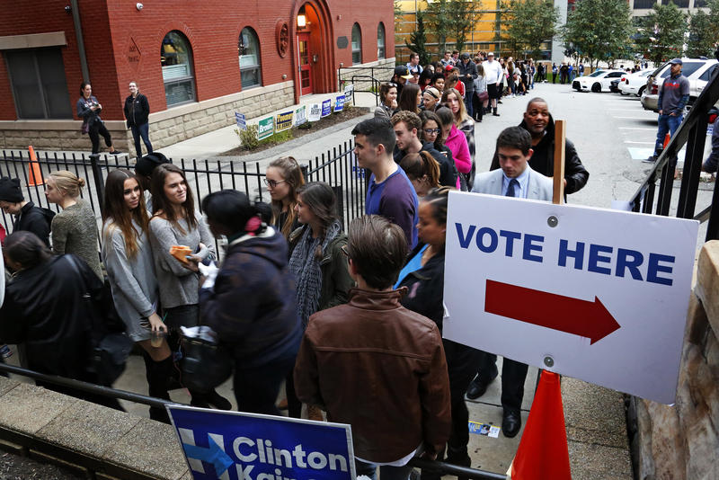Students from Duquesne University wait in line to cast their votes outside Epiphany Catholic Church in Pittsburgh on Tuesday, Nov. 8, 2016.
