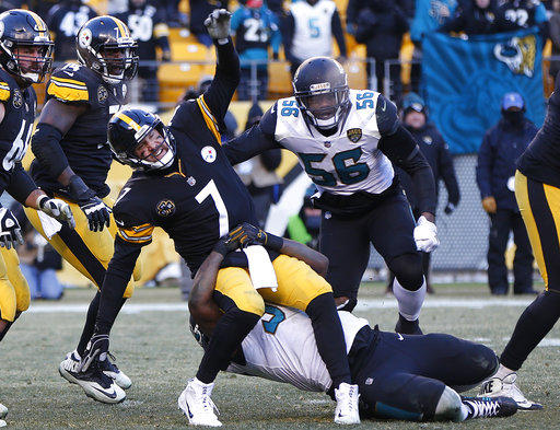 Pittsburgh Steelers quarterback Ben Roethlisberger (7) is hauled down by Jacksonville Jaguars defensive end Calais Campbell (93) after getting off a pass during an NFL divisional football AFC playoff game in Pittsburgh, Sunday, Jan. 14, 2018.