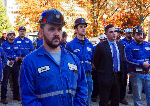 A group of coal miners listens to speakers at a pro-coal rally, Tuesday, Nov. 28, 2017, at the state Capitol in Charleston, W. Va.