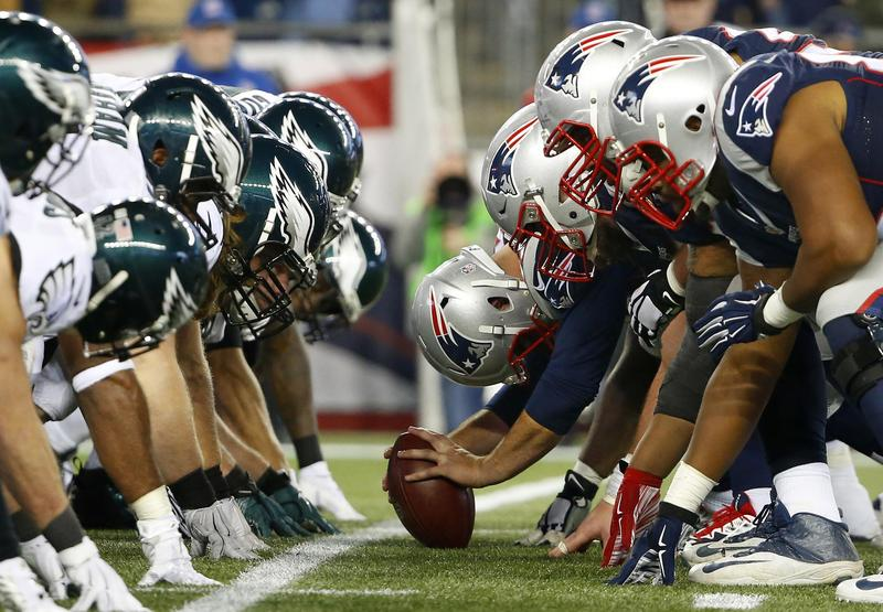 In this Dec. 6, 2015 file photo, the New England Patriots face the Philadelphia Eagles at the line of scrimmage during an NFL game at Gillette Stadium in Foxborough, Mass. The two teams will meet for Super Bowl 52 on Sunday, Feb. 4, 2018, in Minneapolis.