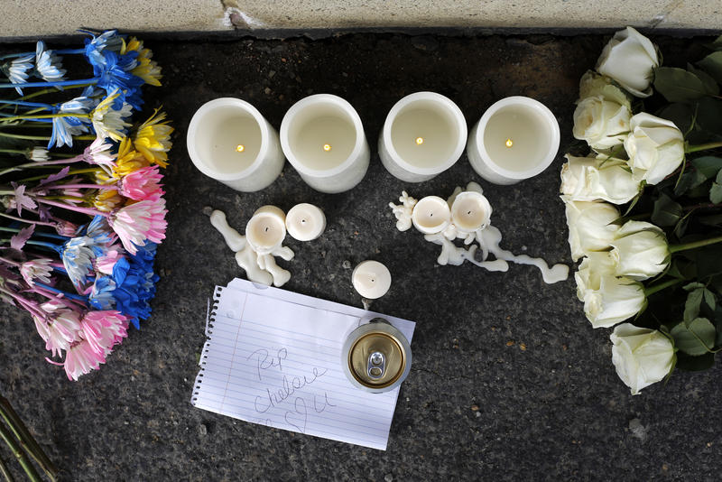 Flowers, candles and a note are at a memorial near Ed's Car Wash after a deadly shooting Monday, Jan. 29, 2018, in Saltlick Township, Pa. State police said Timothy Smith opened fire early Sunday morning at the car wash, killing several.
